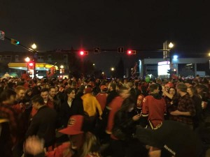 Fans flood the Red Mile  Saturday night after the Calgary Flames defeat the Vancouver Canucks in Game 6. Calgary will face Anaheim in the second round.