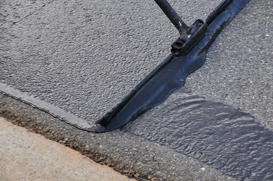 Okotoks Rcmp Issue Warning About Driveway Sealing Scam