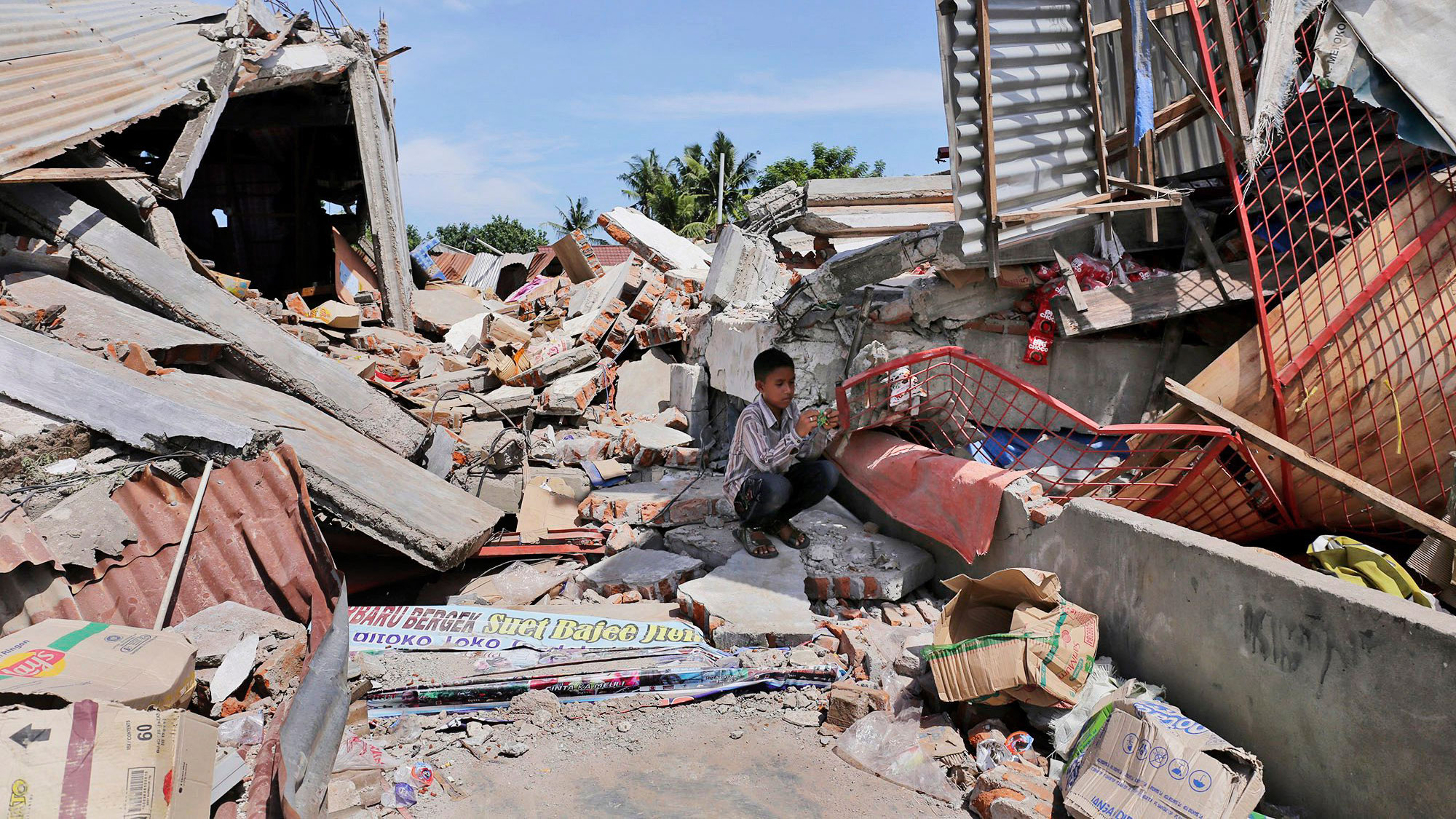 Indonesian towns reel from natural disaster devastation