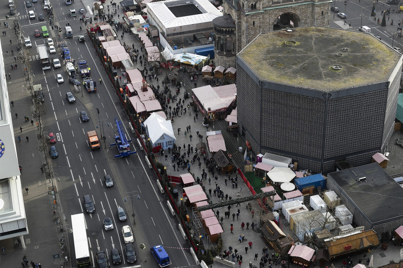 People Walk Over The Reopened Christmas Market Three Days