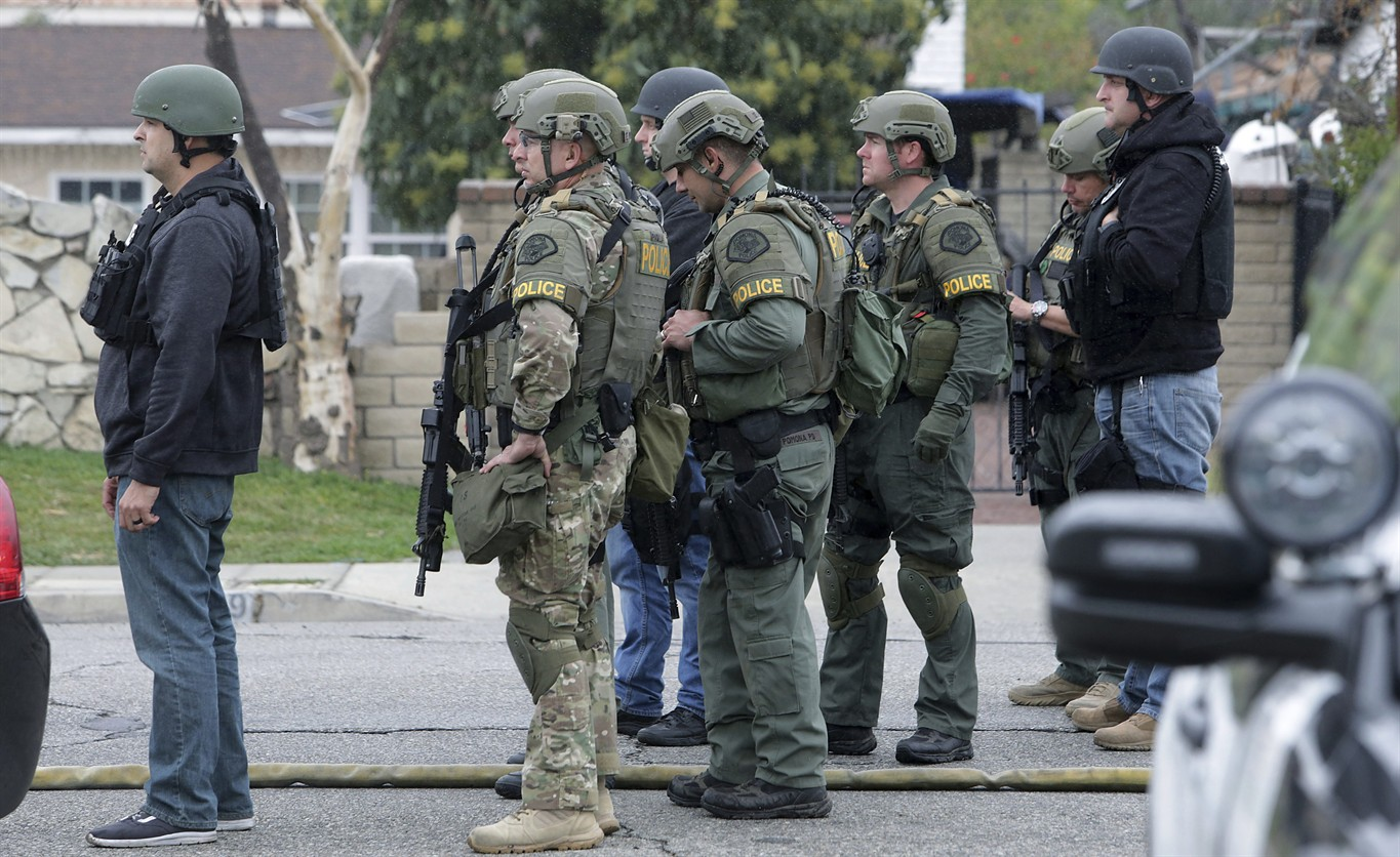 One officer killed, another wounded by suspect in ongoing barricade situation