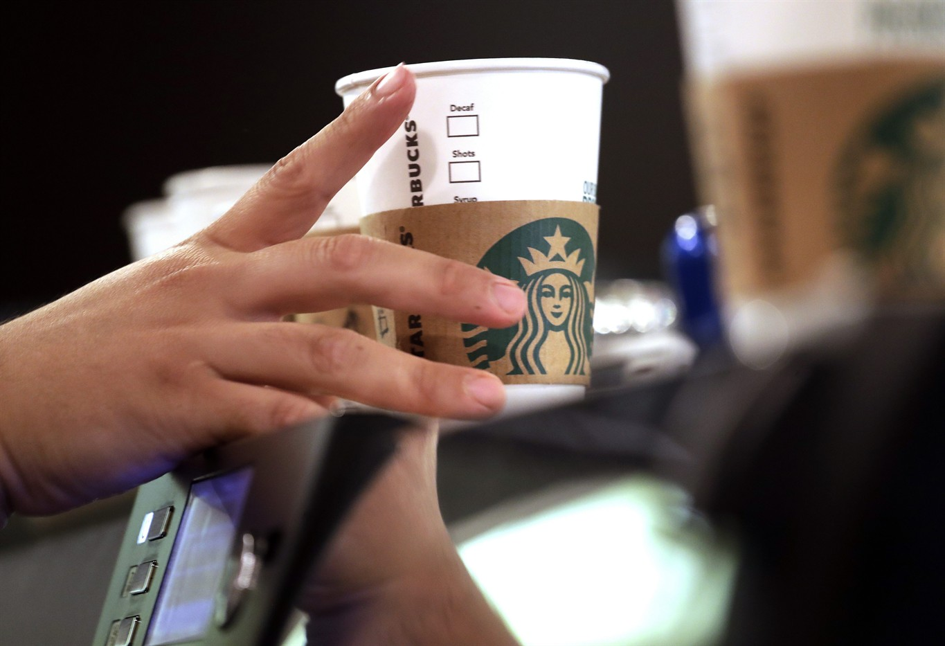 Court starbucks others must pay workers for off clock work 660 file in this may 29 2018 file photo a barista reaches for an empty cup at a starbucks in the pike place market in seattle altavistaventures Choice Image