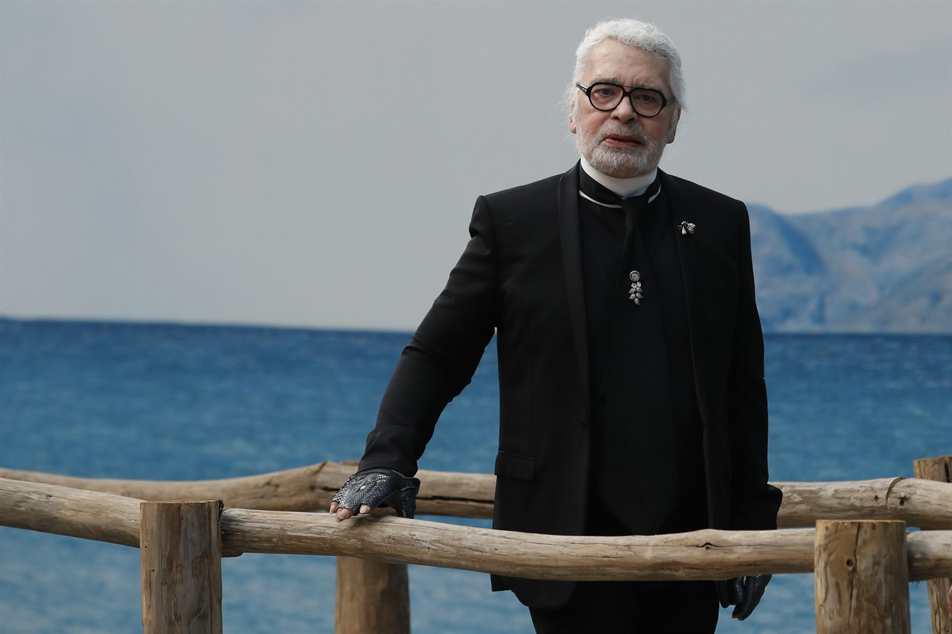 79dc89e156a Fashion designer Karl Lagerfeld poses after the presentation of Chanel  Spring Summer 2019 ready-to-wear fashion collection in Paris