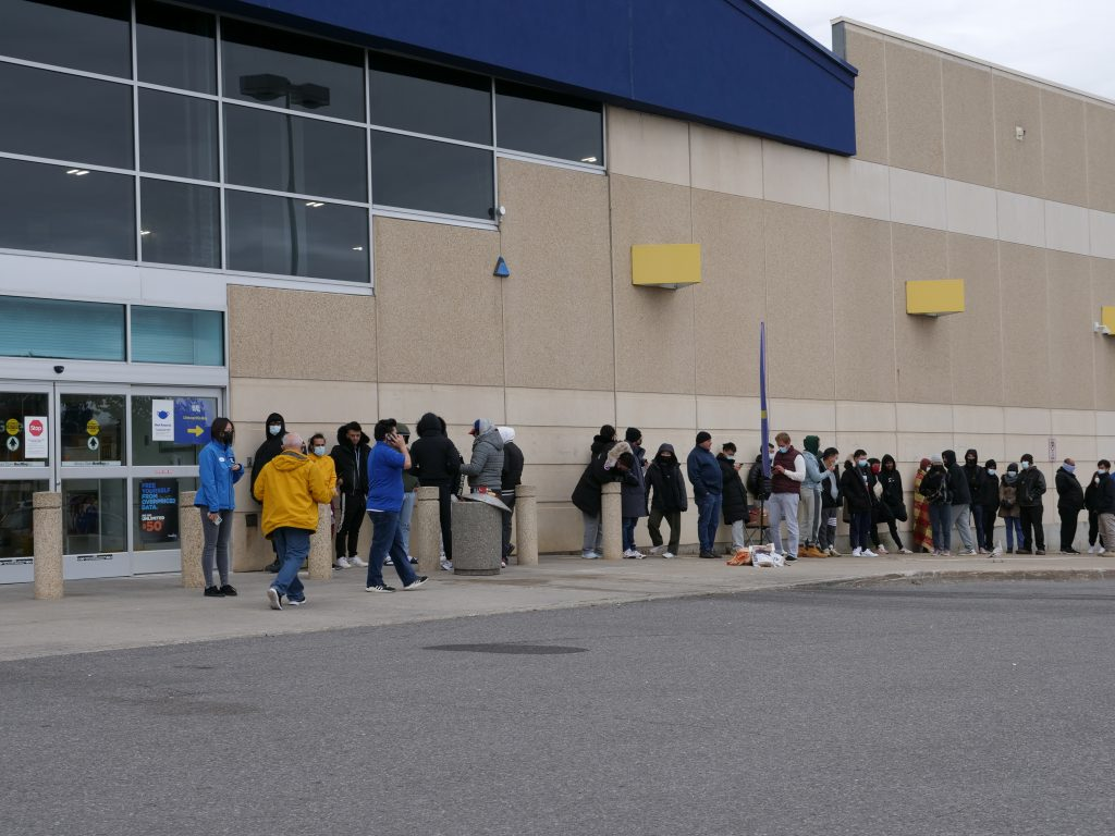 People line up outside Best Buy